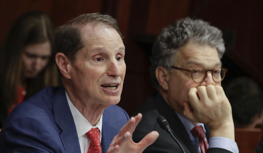 Sen. Ron Wyden, D-Ore., left, with Sen. Al Franken, D-Minn., right, join other Democratic senators at a hearing hosted by the Democratic Policy and Communications Committee about how the GOP health care bill could hurt rural Americans, at the Capitol in Washington, Wednesday, June 21, 2017. Senate Majority Leader Mitch McConnell was expected to push for a vote next week on the legislation, which would eliminate much of Obama's 2010 overhaul and leave government with a diminished role in providing coverage and helping people afford it. (AP Photo/J. Scott Applewhite)