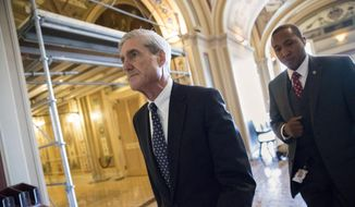Special Counsel Robert Mueller departs after a closed-door meeting with members of the Senate Judiciary Committee about Russian meddling in the election and possible connection to the Trump campaign, at the Capitol in Washington, Wednesday, June 21, 2017. (AP Photo/J. Scott Applewhite)