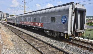 In this June 13, 2017 photo, two sleeper cars from a former Ringling Bros. and Barnum & Bailey Circus train sit temporarily parked on railroad tracks behind the Radisson Lackawanna Station Hotel in Scranton, Pa. The Erie Lackawanna Dining Car Preservation Society, a railroad heritage group that has about 350 members nationwide and is based in Dunmore, Pa., acquired three train cars from the former Ringling Bros. and Barnum & Bailey Circus that will be relocated to the society's Scranton, Pa., storage area. The two sleeper cars rolled into Scranton, Pa., on Sunday, June 11 and the third car, used to transport large animals including elephants, was scheduled to arrive in Scranton, Pa., later in the month after leaving Florida on Friday, June 9. (Jason Farmer /The Times & Tribune via AP)