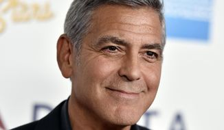 """FILE - In this Saturday, Oct. 1, 2016, file photo, George Clooney arrives at MPTF's 95th Anniversary Celebration """"Hollywood's Night Under The Stars"""" in Los Angeles. Global liquor behemoth Diageo says it will pay up to $1 billion to buy a tequila brand co-founded by movie star George Clooney. Clooney founded the Casamigos brand with partners Rande Gerber and Mike Meldma. Diageo says it will pay $700 million for Casamigos at first, and then pay another $300 million over 10 years if the brand reaches certain performance milestones. (Photo by Jordan Strauss/Invision/AP, File)"""