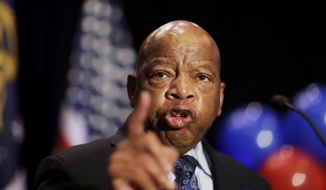 """FILE-In this Tuesday, June 20, 2017 file photo, Rep. John Lewis, D-Ga., speaks at an election night party for Democratic candidate for 6th congressional district Jon Ossoff in Atlanta. Commissioners in a suburban Atlanta county have voted to publicly reprimand a colleague, Commissioner Tommy Hunter, for calling civil rights leader and U.S. Rep. John Lewis a """"racist pig"""" on Facebook. News outlets report the decision on Tuesday, June 20, 2017, followed the recommendation of Gwinnett County's ethics board, which voted earlier in June to sustain the ethics complaint against the Commissioner. (AP Photo/David Goldman, File)"""