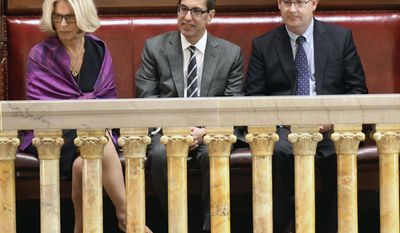 Janet DiFiore, chief judge of the New York Court of Appeals, left, sits with newly confirmed Associate Judge Paul Feinman, center, and his husband Robert Ostergaard, right, in the Senate gallery after being confirmed by the Senate on the last day of the legislative session on Wednesday, June 21, 2017, in Albany, N.Y. (AP Photo/Hans Pennink)