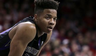 FILE - In this Jan. 29, 2017, file photo, Washington guard Markelle Fultz (20) is shown during the second half of an NCAA college basketball game against Arizona, in Tucson, Ariz. Fultz is the likely No. 1 pick in the NBA Draft on Thursday night, June 22. (AP Photo/Rick Scuteri, File)