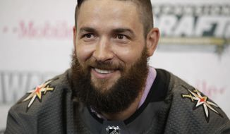 Vegas Golden Knights' Deryk Engelland poses for photographers Wednesday, June 21, 2017, in Las Vegas. Engelland was picked by the Vegas Golden Knights in the NHL expansion draft. (AP Photo/John Locher)