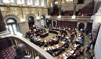 Senators work In the Senate chamber at the state Capitol during the last day of the legislative session on Wednesday, June 21, 2017, in Albany, N.Y. (AP Photo/Hans Pennink)