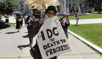 John Gromada of Nyack, N.Y., and members of the Rockland Citizens Action Network stage a jazz funeral for the death of progressive legislation at the state Capitol during the last day of the legislative session on Wednesday, June 24, 2017, in Albany, N.Y. (AP Photo/Hans Pennink)