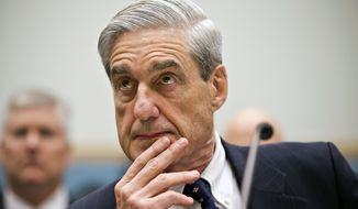 Then-FBI Director Robert Mueller listens as he testifies on Capitol Hill in Washington, as the House Judiciary Committee held an oversight hearing on the FBI in this June 13, 2013, file photo.  (AP Photo/J. Scott Applewhite) ** FILE **