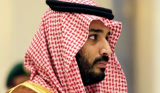 Saudi Arabian Deputy Crown Prince Mohammed bin Salman attends a summit of Arab and Latin American leaders in Riyadh, Saudi Arabia, in this Nov. 11, 2015, file photo. Saudi Arabia's King Salman has appointed his 31-year-old son Mohammed bin Salman as crown prince, removing the country's counterterrorism czar and a figure well-known to Washington from the royal line of succession. In a series of royal decrees issued Wednesday, June 21, 2017, and carried on the state-run Saudi Press Agency, the monarch stripped Prince Mohammed bin Nayef, who was first in line to the throne, from his title as crown prince and from his post as the country's powerful interior minister overseeing security. (AP Photo/Hasan Jamali, File)