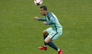 Portugal's Cristiano Ronaldo jumps for the ball during the Confederations Cup, Group A soccer match between Russia and Portugal, at the Spartak Stadium in Moscow, Wednesday, June 21, 2017. (AP Photo/Alexander Zemlianichenko)