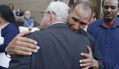 Mahmoud Hassanen Aboras, father of Nabra Hassanen, who was killed over the weekend in a road rage incident, right, gets a hug from Virginia congressman, Gerry Connolly, D-Va, prior to the start of a vigil in honor of Nabar Wednesday, June 21, 2017, in Reston, Va. (AP Photo/Steve Helber)