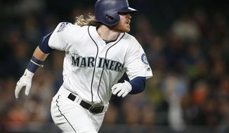 Seattle Mariners' Ben Gamel watches his home run off Detroit Tigers pitcher Daniel Stumpf during the seventh inning of a baseball game Tuesday, June 20, 2017, in Seattle. (AP Photo/Lindsey Wasson)