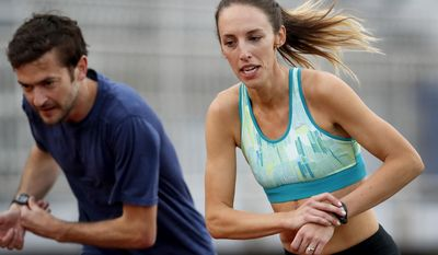 FILE - In this May 8, 2017, file photo, Gabriele Grunewald trains at Macalester College in St. Paul, Minn. Grunewald is two weeks into chemotherapy to treat cancer that's gone from her salivary gland to her liver. That won't keep her from taking the starting line for the 1,500 meters Thursday, June 22, at the U.S. track and field championships. (Carlos Gonzalez/Star Tribune via AP, File)