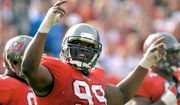In this Jan. 12, 2003, file photo, Tampa Bay Buccaneers' Warren Sapp tries to get the crowd going during the third quarter of the NFC divisional NFL football playoff game against the San Francisco 49ers in Tampa, Fla. Sapp is donating his brain for medical research. Sapp announced on social media Tuesday, June 20, 2017, that his brain will go to the Concussion Legacy Foundation after his death. The 44-year-old said in a statement that he's started to feel the effects of the many hits he took during his 13-year NFL career. (AP Photo/Steve Nesius, File)