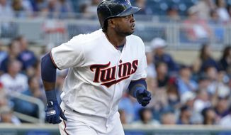 Minnesota Twins' Miguel Sano watches his two-run home run against the Chicago White Sox during the first inning of a baseball game Tuesday, June 20, 2017, in Minneapolis. (AP Photo/Bruce Kluckhohn)