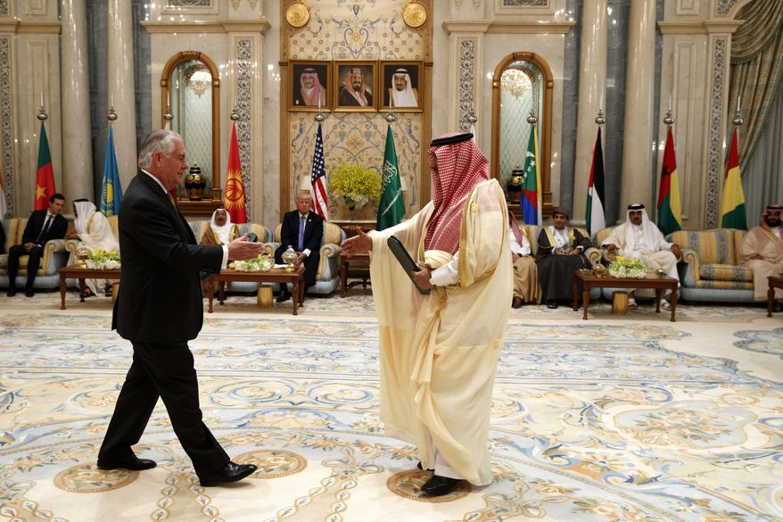 FILE- In this Sunday, May 21, 2017, file photo, U.S. President Donald Trump, center rear,  looks on as Secretary of State Rex Tillerson, left, and then Saudi Crown Prince Muhammad bin Nayef exchange an agreement against the funding militant groups, during a meeting of the Gulf Cooperation Council, at the King Abdulaziz Conference Center, in Riyadh, Saudi Arabia. Mohammed bin Salman was named crown prince in a sudden royal shake-up in Saudi Arabia early on Wednesday, June 21, 2017,  but that is just the latest wild card in days of head-spinning developments in the typically staid Gulf, including the unexpected cutting off of nominal ally Qatar from the powerful Gulf Cooperation Council and Iran firing a missile into Syria for the first time, targeting Islamic State militants (AP Photo/Evan Vucci, File)
