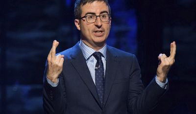 "In this Feb. 28, 2015, file photo, John Oliver speaks in New York. Coal company Murray Energy is suing HBO and its Sunday-night host, John Oliver, for what it says was a false and malicious broadcast. Oliver's 24-minute ""Last Week Tonight"" coal segment on Sunday, June 18, 2017, criticized the Trump's administration effort to revive the industry and ribbed Murray Energy's CEO. (Photo by Charles Sykes/Invision/AP, File)"