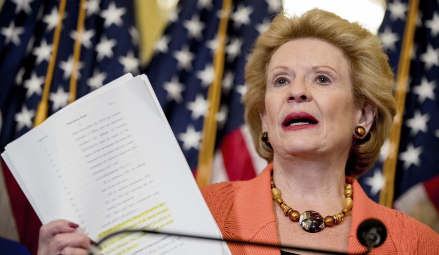Sen. Debbie Stabenow, D-Mich., holds up a copy of the proposed Senate Republican health bill as she discusses the effects of the proposed Republican health care legislation on families at a news conference on Capitol Hill in Washington, Thursday, June 22, 2017. (AP Photo/Andrew Harnik)