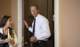 Sen. John Thune, R-S.D., the Republican Conference chairman, leaves a closed-door meeting where Senate Majority Leader Mitch McConnell, R-Ky., announced the release of the Republican healthcare bill, the party's long-awaited attempt to scuttle much of President Barack Obama's Affordable Care Act, at the Capitol in Washington, Thursday, June 22, 2017. (AP Photo/J. Scott Applewhite)