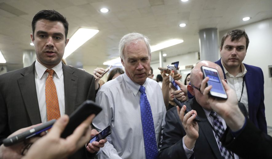 Sen. Ron Johnson, R-Wis., makes his way through a crush of reporters at the Capitol after Republicans released their long-awaited bill to scuttle much of President Barack Obama's Affordable Care Act, at the Capitol in Washington, Thursday, June 22, 2017. He is one of four GOP senators to say they are opposed it but are open to negotiations, which could put the measure in immediate jeopardy. (AP Photo/J. Scott Applewhite)