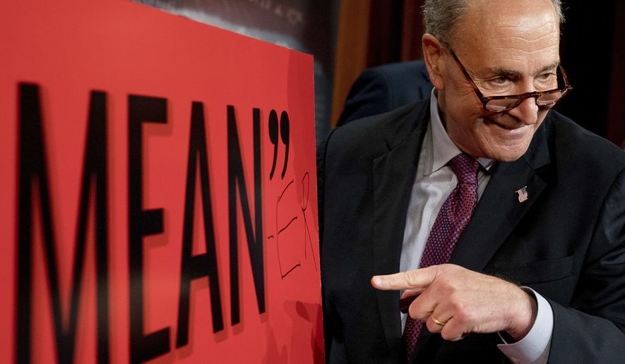 "Senate Minority Leader Chuck Schumer, D-N.Y., writes ""Mean-er"" on a reported quote by President Donald Trump as Schumer responds to the release of the Republicans' healthcare bill which represents the long-awaited attempt to scuttle much of President Barack Obama's Affordable Care Act, at the Capitol in Washington, Thursday, June 22, 2017. (AP Photo/Andrew Harnik)"