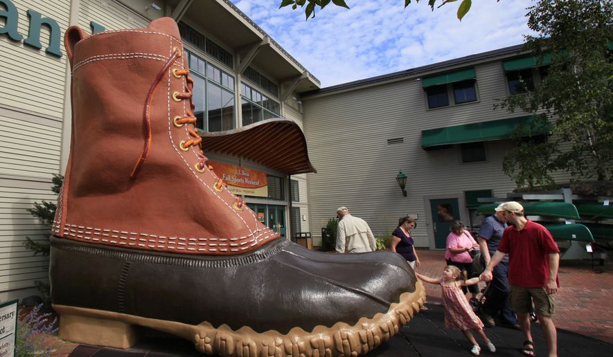 In this Aug. 20, 2009, file photo, shoppers pause at the giant boot outside the L.L. Bean flagship store in Freeport, Maine. As a summer vacation destination, Maine has something for everyone, from hiking and beaches to adventure and the arts. (AP Photo/Robert F. Bukaty, File)