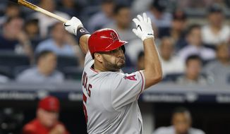 Los Angeles Angels' Albert Pujols follows through on a seventh-inning RBI single in a baseball game against the New York Yankees in New York, Thursday, June 22, 2017. (AP Photo/Kathy Willens)