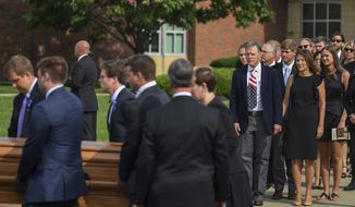 Fred and Cindy Warmbier watch as their son Otto, is placed in a hearse after his funeral, Thursday, June 22, 2017, in Wyoming, Ohio. Otto Warmbier, a 22-year-old University of Virginia student who was sentenced in March 2016 to 15 years in prison with hard labor in North Korea, died this week, days after returning to the United States. (AP Photo/Bryan Woolston)e