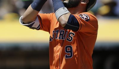 Houston Astros' Marwin Gonzalez celebrates after hitting a three-run home run off Oakland Athletics pitcher Jesse Hahn in the first inning of a baseball game Thursday, June 22, 2017, in Oakland, Calif. (AP Photo/Ben Margot)