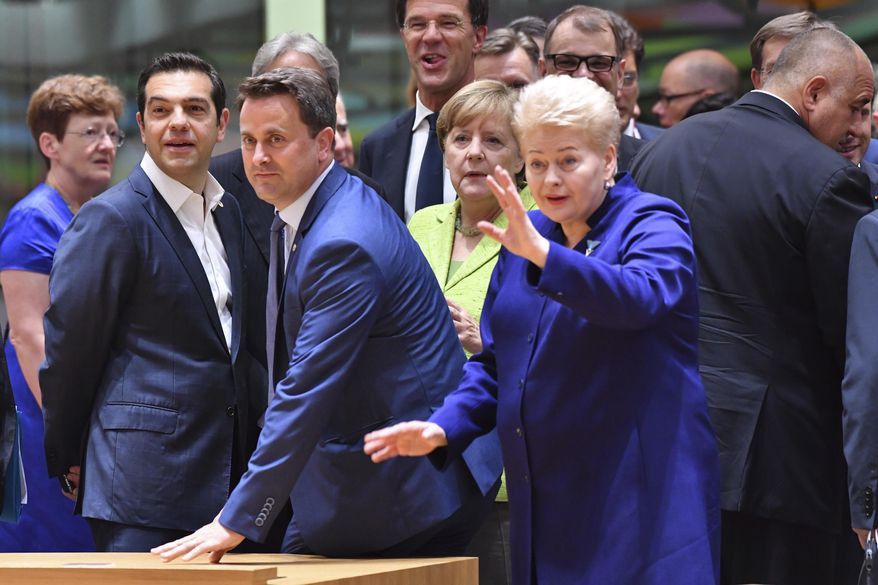 EU leaders from second left, Greek Prime Minister Alexis Tsipras, Luxembourg's Prime Minister Xavier Bettel, Dutch Prime Minister Mark Rutte, German Chancellor Angela Merkel and Lithuanian President Dalia Grybauskaite look across the room during a round table meeting at an EU summit in Brussels on Thursday, June 22, 2017. European Union leaders are gathering for a two day summit to weigh measures in which to tackle terrorism and migration and to create closer defense ties. (AP Photo/Geert Vanden Wijngaert)