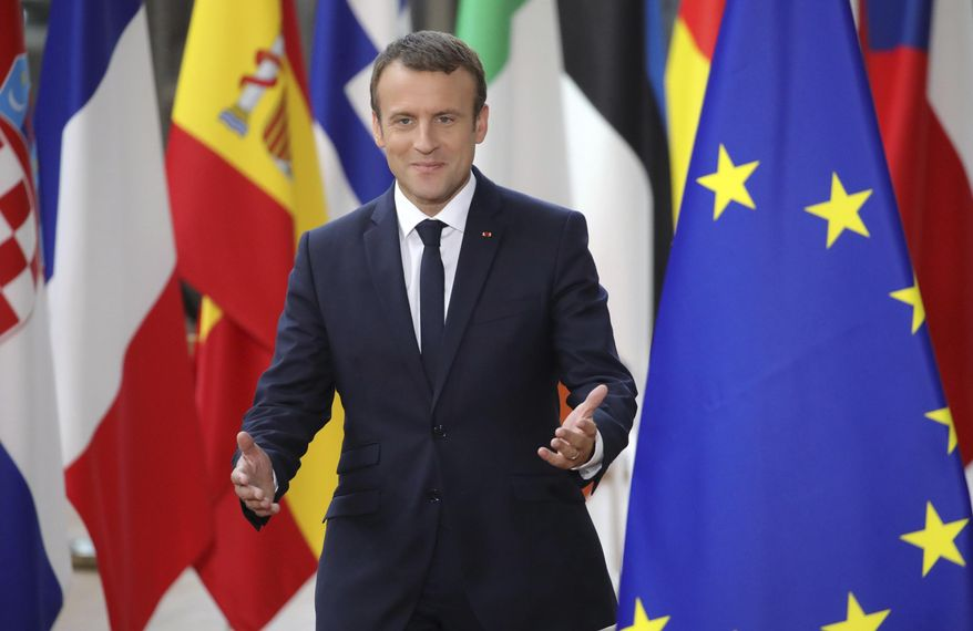 French President Emmanuel Macron arrives for an EU summit at the Europa building in Brussels on Thursday, June 22, 2017. European Union leaders are gathering for a two day summit to weigh measures in which to tackle terrorism and migration and to create closer defense ties. (AP Photo/Olivier Matthys)