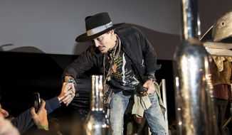 Actor Johnny Depp greets fans at the Glastonbury music festival at Worthy Farm, in Somerset, England, Thursday, June 22, 2017. (Photo by Grant Pollard/Invision/AP)