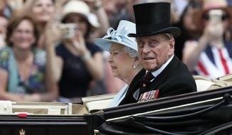 FILE - In this Saturday, June 17, 2017 file photo, Britain's Queen Elizabeth II and Prince Philip return to Buckingham Palace in a carriage, after attending the annual Trooping the Colour Ceremony in London. Buckingham Palace said on Wednesday June 21, 2017, Prince Philip is good spirits after being admitted to hospital. (AP Photo/Kirsty Wigglesworth, File)