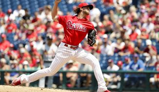 Philadelphia Phillies' Aaron Nola pitches during the third inning of a baseball game against the St. Louis Cardinals, Thursday, June 22, 2017, in Philadelphia. (AP Photo/Matt Slocum)