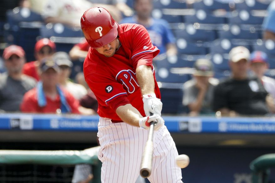 Philadelphia Phillies' Tommy Joseph hits a two-run single off St. Louis Cardinals relief pitcher Kevin Siegrist during the eighth inning of a baseball game, Thursday, June 22, 2017, in Philadelphia. Philadelphia won 5-1. (AP Photo/Matt Slocum)