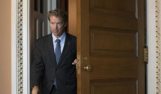 Sen. Rand Paul, R-Ky., leaves a closed-door meeting where Senate Majority Leader Mitch McConnell, R-Ky., announced the release of the Republican health care bill, the party's long-awaited attempt to scuttle much of President Barack Obama's Affordable Care Act, at the Capitol in Washington, Thursday, June 22, 2017. (AP Photo/J. Scott Applewhite)
