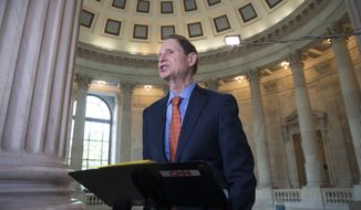 Sen. Ron Wyden, D-Ore., speaks during a TV news interview at the Capitol in Washington, Thursday, June 22, 2017. (AP Photo/J. Scott Applewhite) ** FILE **