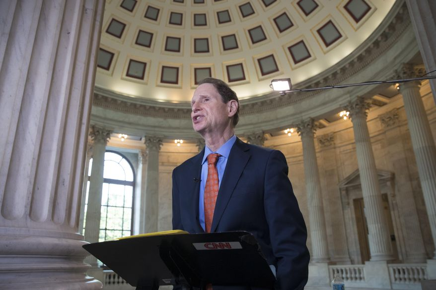 Sen. Ron Wyden, D-Ore., speaks during a TV news interview at the Capitol in Washington, Thursday, June 22, 2017. (AP Photo/J. Scott Applewhite) ** FILE **