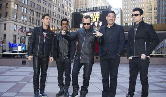 """New Kids Kids On The Block members, from left, Joey McIntyre, Danny Wood, Donnie Wahlberg, Jonathan Knight and Jordan Knight announce their """"The Main Event"""" tour at Madison Square Garden on Tuesday, Jan. 20, 2015, in New York. (Photo by Charles Sykes/Invision/AP)"""