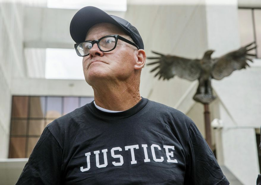 John Floyd stands in front of the Hale Boggs Federal Building and Courthouse in New Orleans, Thursday, June 22, 2017.  Floyd, who was imprisoned for 36 years, walked free Thursday after a federal judge threw out his murder conviction and life sentence for a newspaper editor's stabbing in the French Quarter of New Orleans. (AP Photo/Sophia Germer)