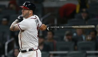 Atlanta Braves first baseman Matt Adams (18) follows through on a two-run home run in the fourth inning of a baseball game against the San Francisco Giants Wednesday, June 21, 2017, in Atlanta. (AP Photo/John Bazemore)