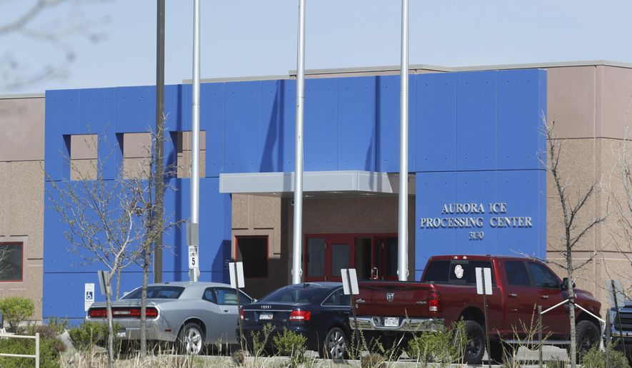 In this Saturday, April 15, 2017, photograph, the entrance to the GEO Group's immigrant detention facility is shown in Aurora, Colo. People once held in a privately run Colorado immigration detention center are challenging the system used to keep it clean and maintained, arguing it borders on slavery. They have won the right to sue GEO Group on behalf of an estimated 60,000 people held at its detention center near Denver over a decade. (AP Photo/David Zalubowski)