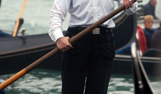 Alex Hai is seen as he rows on a gondola in Venice in an undated file photo. Hai, a gondolier who made headlines a decade ago for being Venice's first official female gondolier has announced he is transgender. Alex Hai made the revelation Wednesday, June 21, 2017, on Facebook and in a lengthy interview on Radiolab. (Andrea Merola/ANSA via AP)