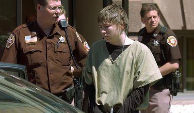 "FILE - In a May 4, 2006 file photo, Brendan Dassey, center, is lead out of the Manitowoc County Courthouse following his motion hearing in Manitowoc, Wis. A three-judge panel from the 7th Circuit on Thursday, June 22, 2017 affirmed that Dassey, a Wisconsin inmate featured in the Netflix series ""Making a Murderer"" was coerced into confessing and should be released from prison. Dassey was sentenced to life in prison in 2007 in photographer Teresa Halbach's death two years earlier.  (Eric Young/Herald-Times Reporter via AP, File)"