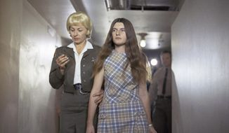 FILE - In this Feb. 24, 1970 file photo, Patricia Krenwinkel, a defendant in the Tate murder case, enters the superior court in Los Angeles for an arraignment. Krenwinkel, a follower of cult killer Charles Manson, is again seeking parole Thursday 22, 2017. (AP Photo/George Brich, File)