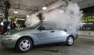 FILE - In this April 16, 2015 file photo, smoke created by water vapor billows out of the windows of a car, used by Colorado to fight stoned driving with youth demographics, during a demonstration by the Colorado Department of Transportation in southeast Denver. The Highway Loss Data Institute, a leading insurance research group, said in study results released Thursday that collision claims in Colorado, Washington, and Oregon went up 2.7 percent in the years since legal recreational marijuana sales began when compared with surrounding states. (AP Photo/David Zalubowski, file)