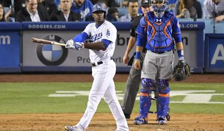 Los Angeles Dodgers' Yasiel Puig slowly leaves the plate after hitting a three-run home run, while New York Mets catcher Travis d'Arnaud, right, watches along with home plate umpire Lance Barksdale during the fourth inning of a baseball game, Wednesday, June 21, 2017, in Los Angeles. (AP Photo/Mark J. Terrill)