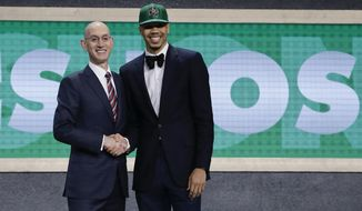 Duke's Jayson Tatum, right, poses for photos with NBA Commissioner Adam Silver after being selected by the Boston Celtics as the No. 3 pick overall during the NBA basketball draft, Thursday, June 22, 2017, in New York. (AP Photo/Frank Franklin II)