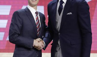 Bam Adebayo, right, poses for photos with NBA Commissioner Adam Silver after being selected by the Miami Heat as the 14th pick overall during the NBA basketball draft, Thursday, June 22, 2017, in New York. (AP Photo/Frank Franklin II)