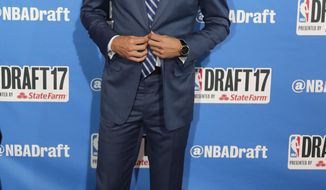 Duke's Luke Kennard poses for photos on the red carpet before the NBA basketball draft, Thursday, June 22, 2017, in New York. (AP Photo/Frank Franklin II)