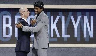 Texas center Jarrett Allen is congratulated by NBA Commissioner Adam Silver after being selected by the Brooklyn Nets as the 22nd pick overall during the NBA basketball draft, Thursday, June 22, 2017, in New York. (AP Photo/Frank Franklin II)
